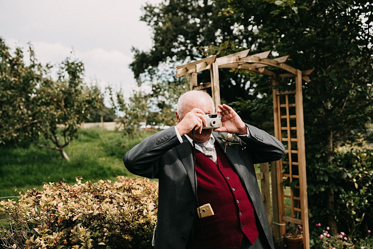 Wedding guest taking photos