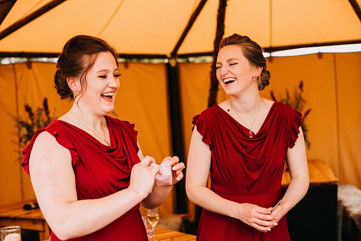 Bridesmaids wearing burgundy dresses