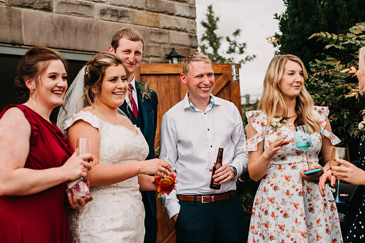 Guests enjoying drinks at the garden wedding