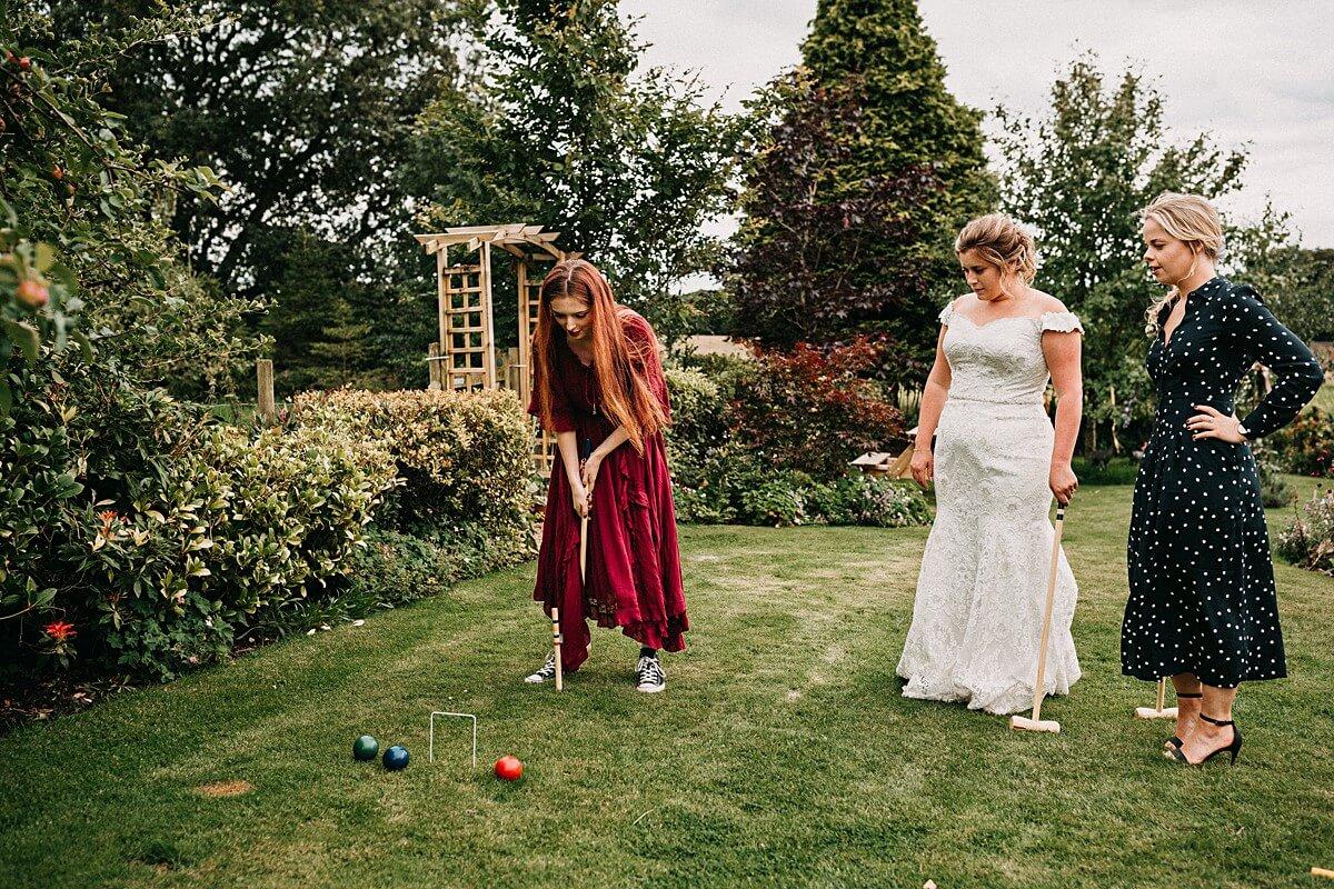 Garden games at the outdoor tipi wedding