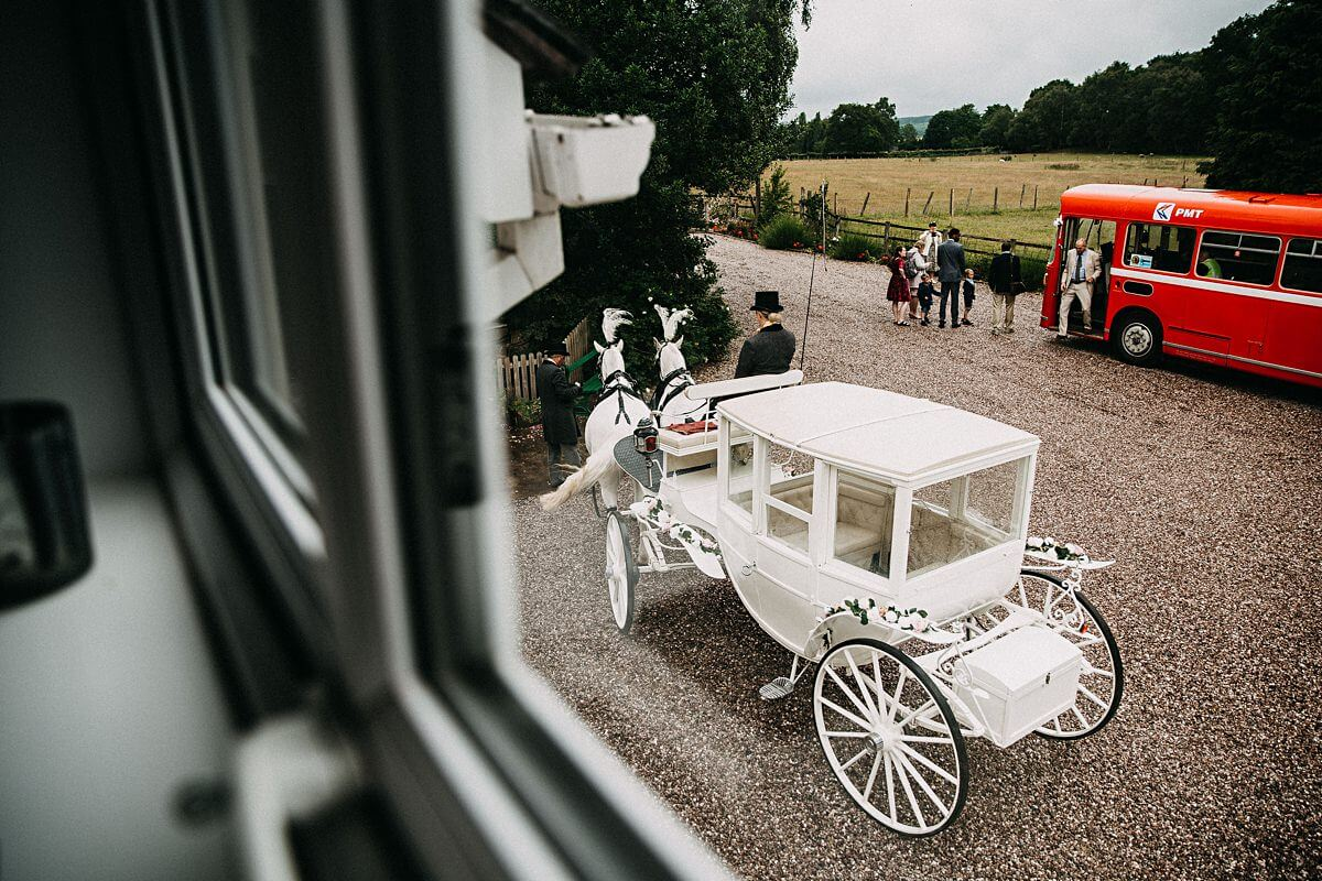 Horse and carriage and vintage wedding bus