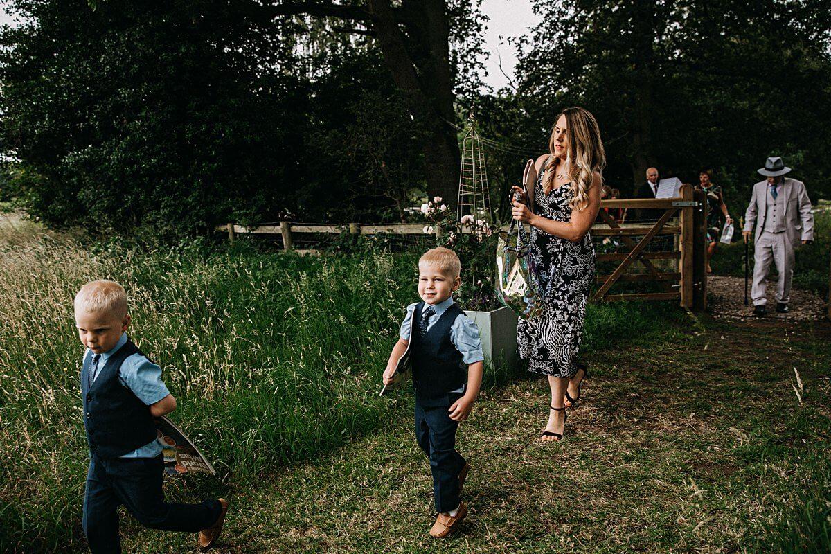 Guests walking to the outdoor garden wedding