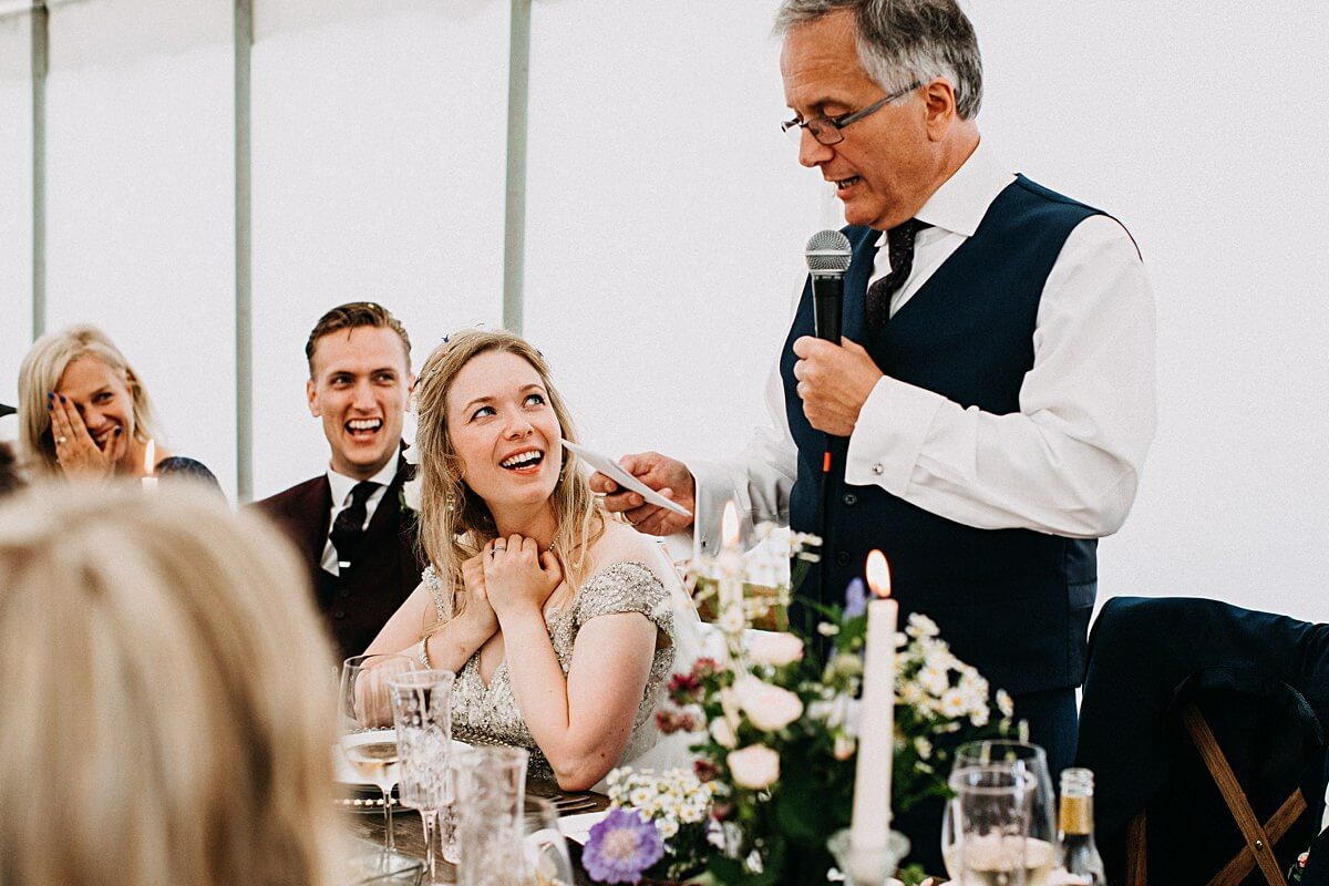 Beautiful bride and her reaction of the father's speech