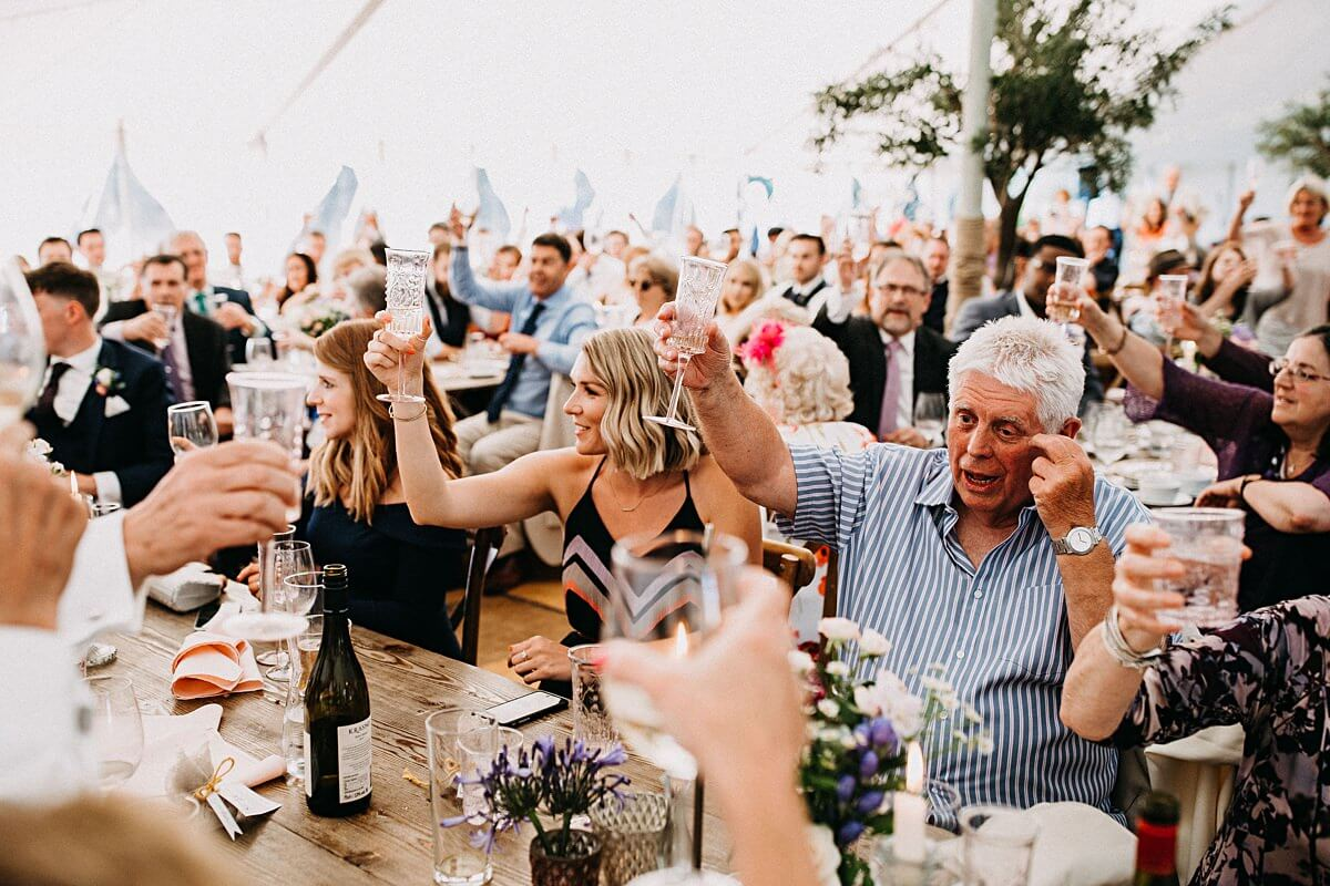 Guests cheers at the wedding speeches