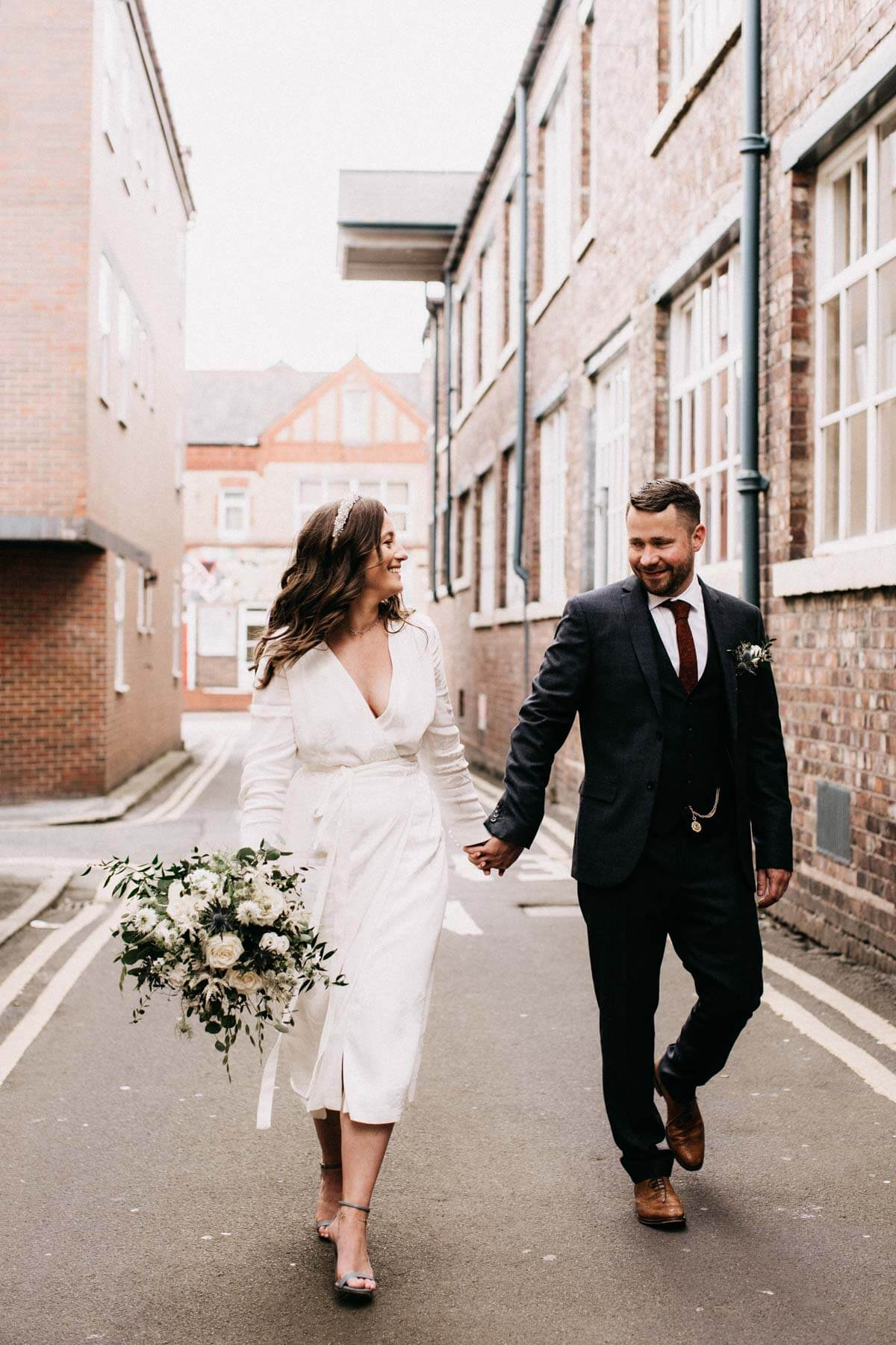 Wedding couple walking down Cheshire street