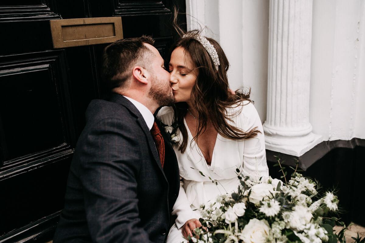 Newlyweds kiss on steps in Warrington