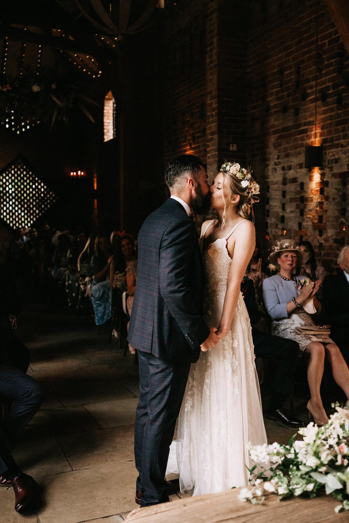 Beautiful first kiss at Shustoke Farm wedding