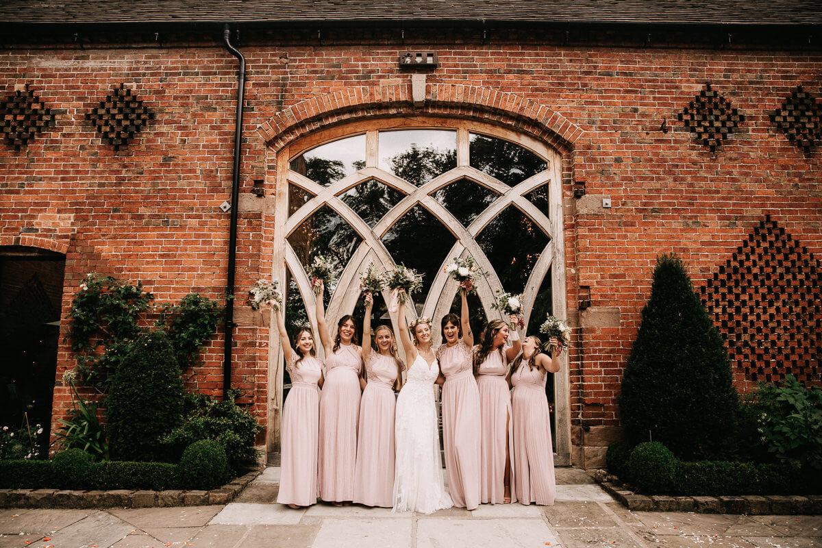 Bridesmaids wearing blush pink dresses