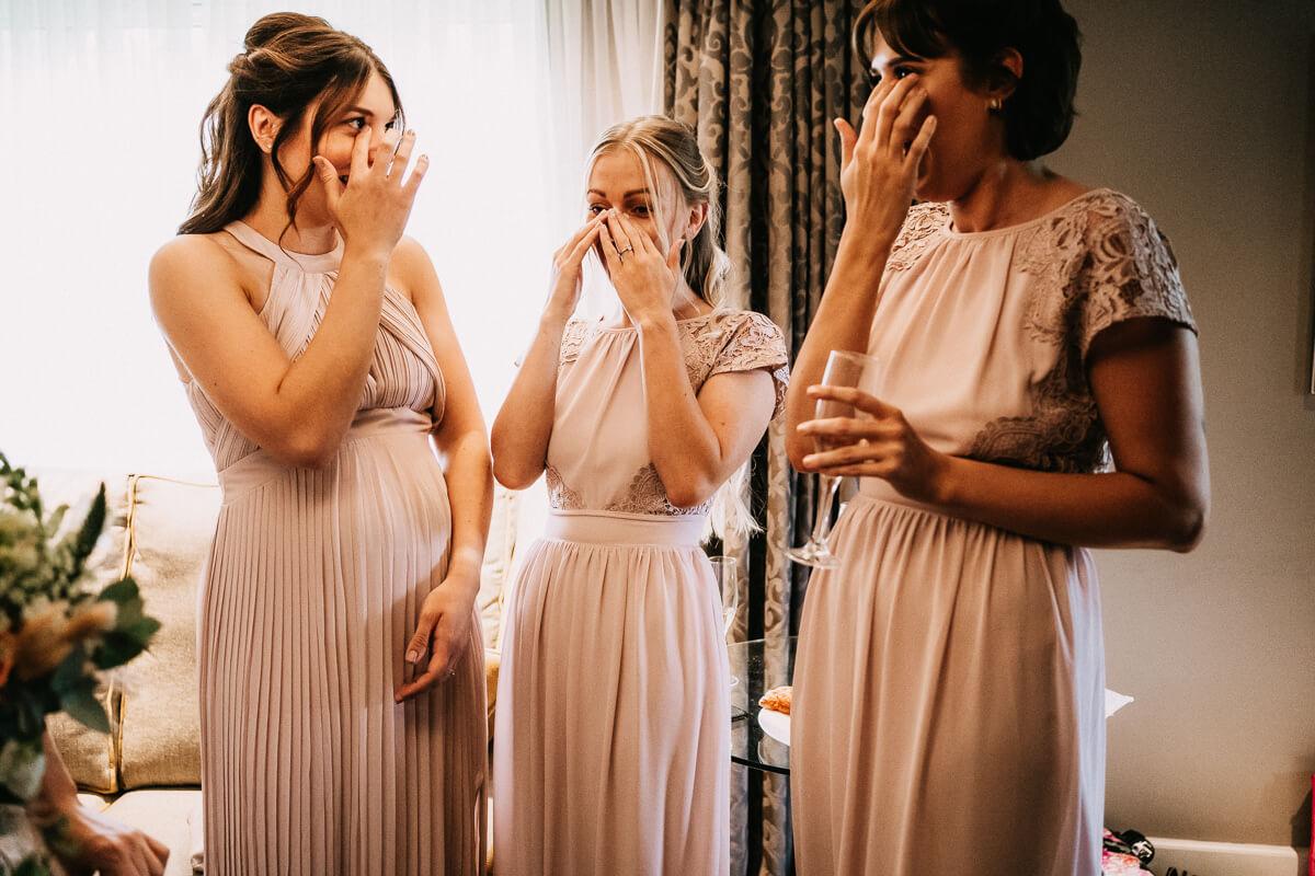 Bridesmaids emotional photo