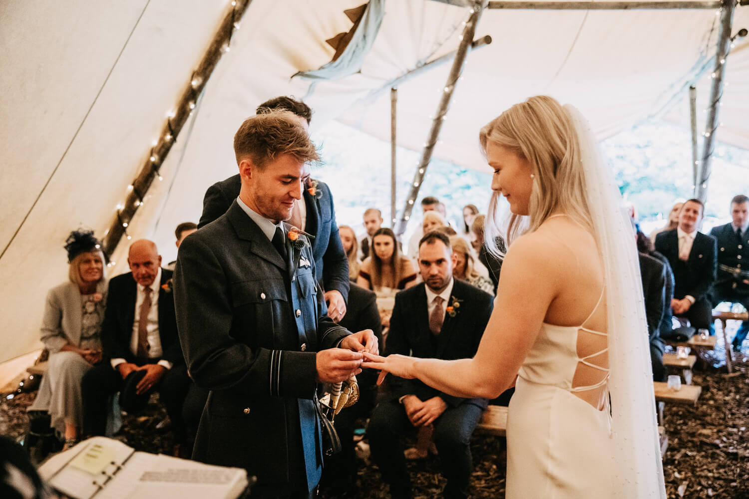 Exchanging rings at the outdoor ceremony