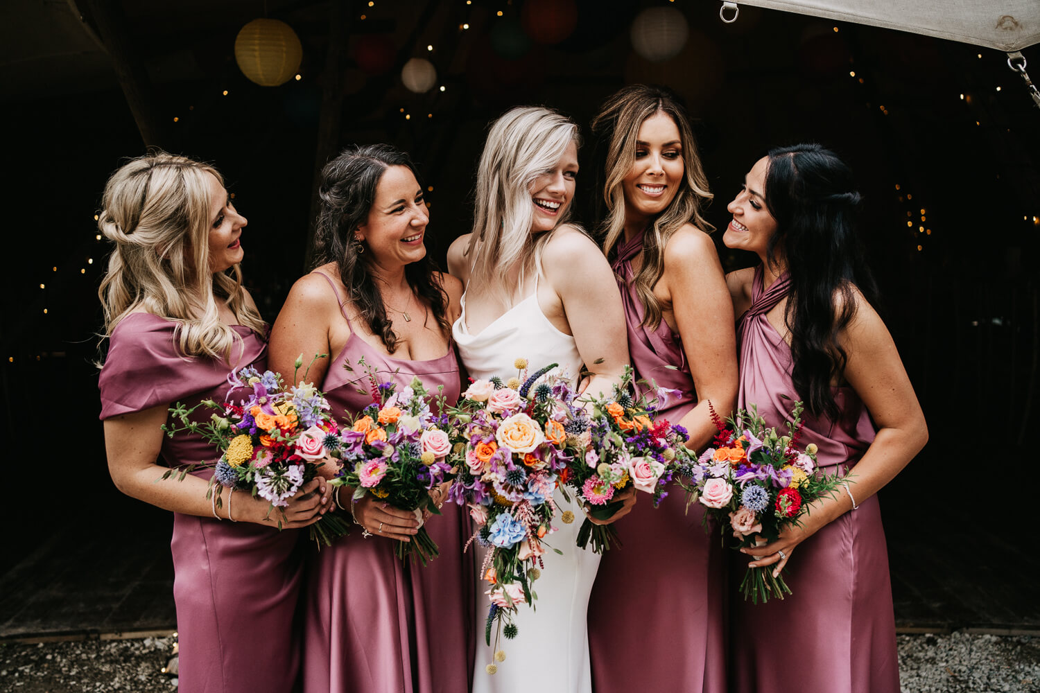 Pink bridesmaids dresses and colourful wedding bouquet