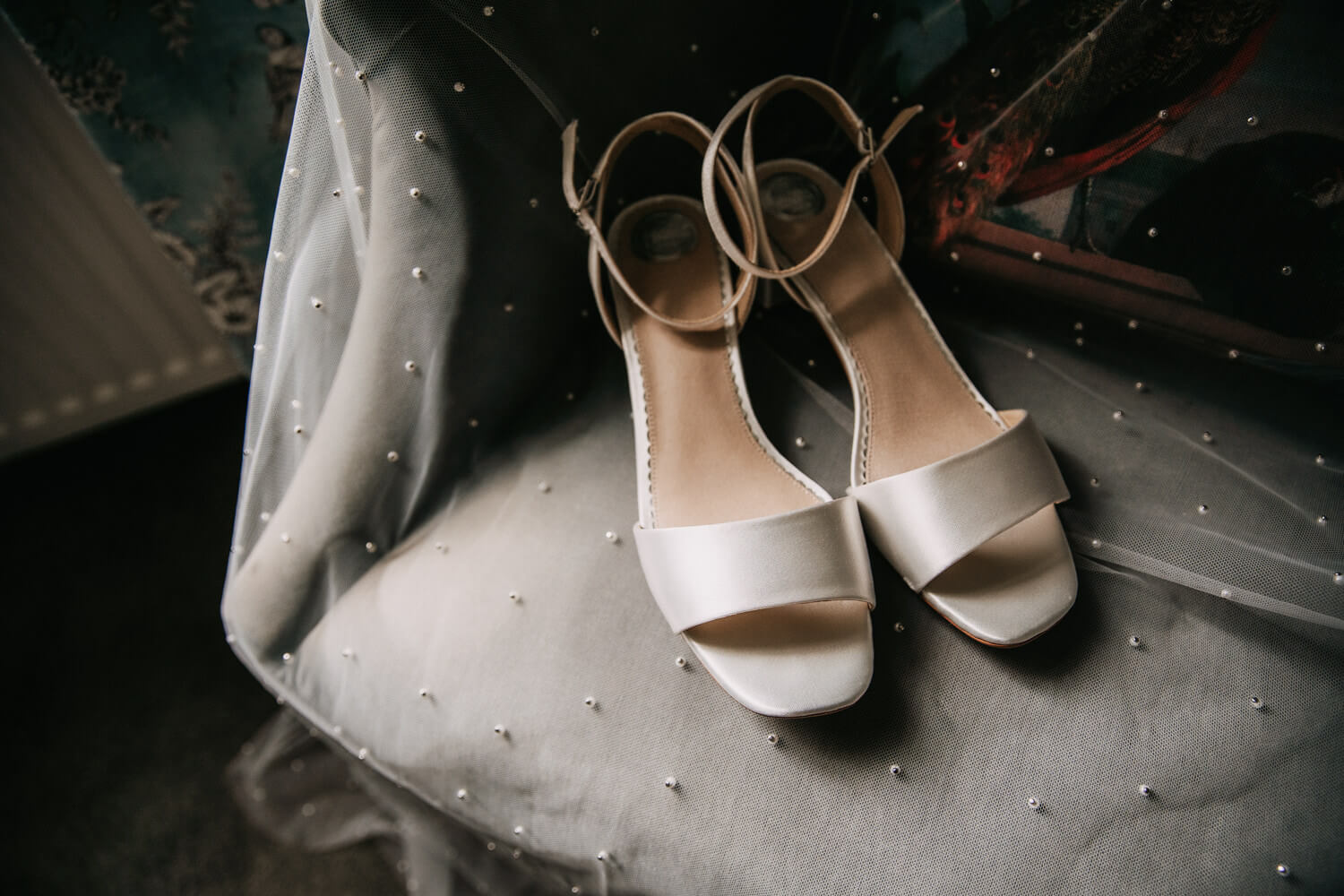 Classic white wedding shoes and beaded veil