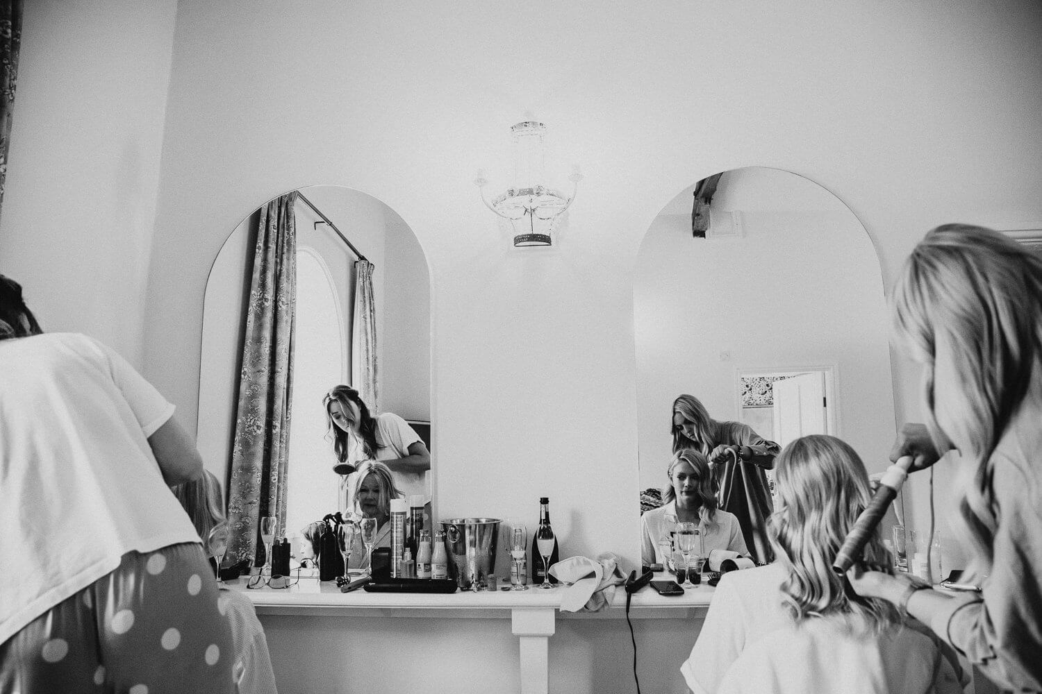 Brides and her bridesmaids getting ready for the wedding