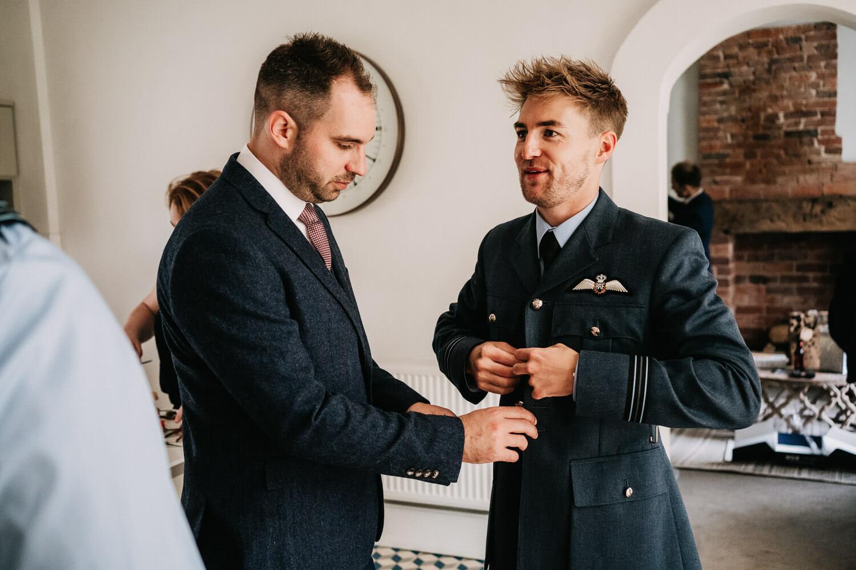 Groom getting into his RAF uniform