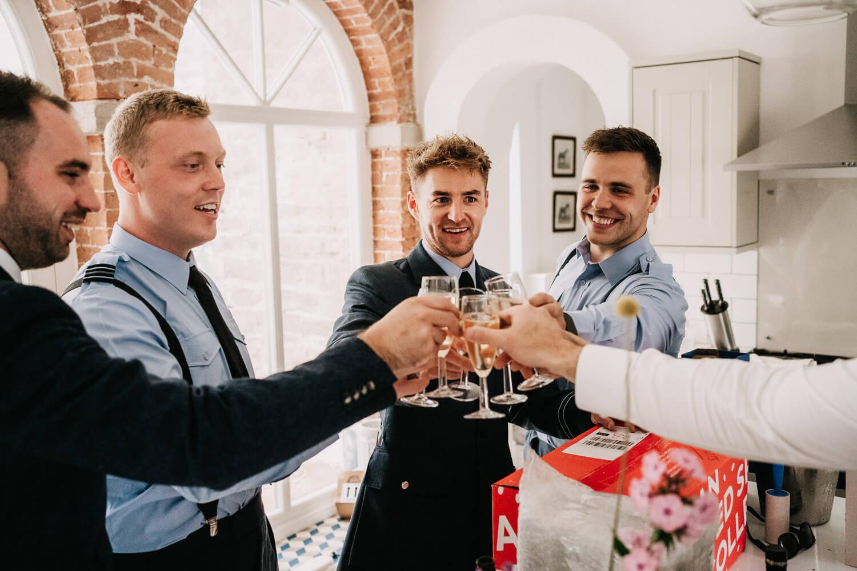 Celebratory drinks with the groom