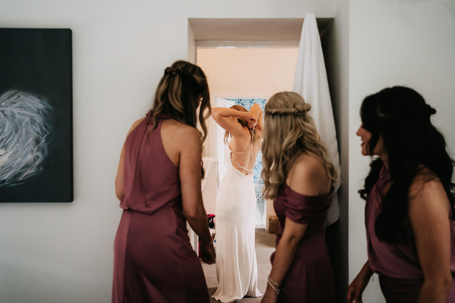 Bride getting into her Grace Loves Lace dress